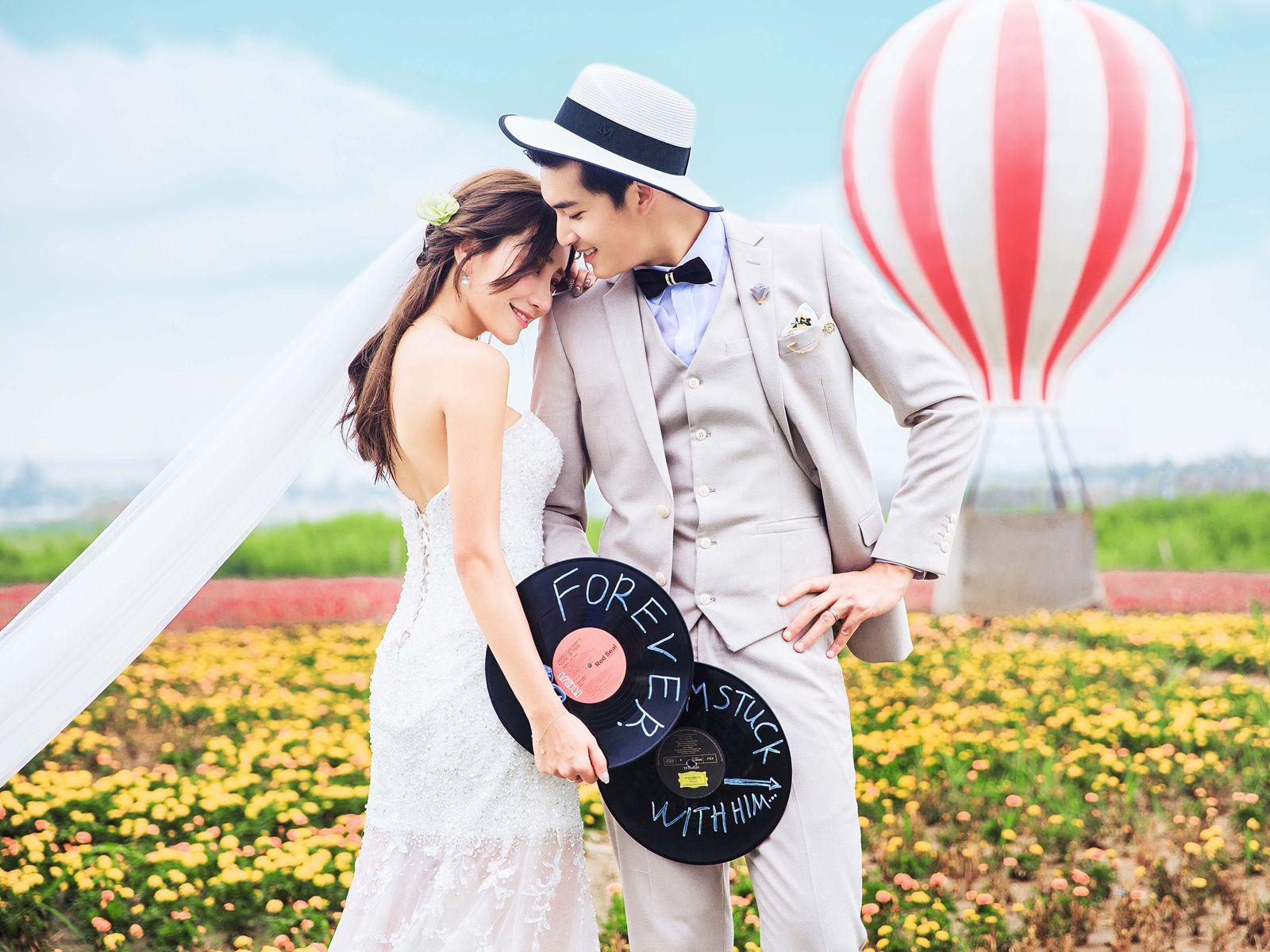 洋杨喜圣罗曼婚纱摄影