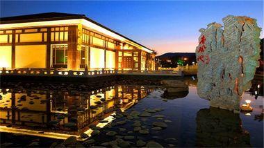 【大连等】大连唐风温泉酒店1晚+双早+双人发现王国门票+双人唐风温泉门票-美团