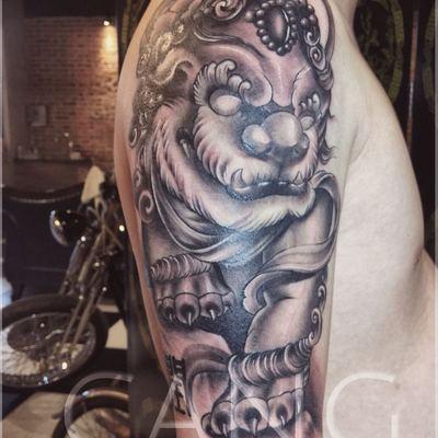 大臂唐狮,新传统风格纹身图