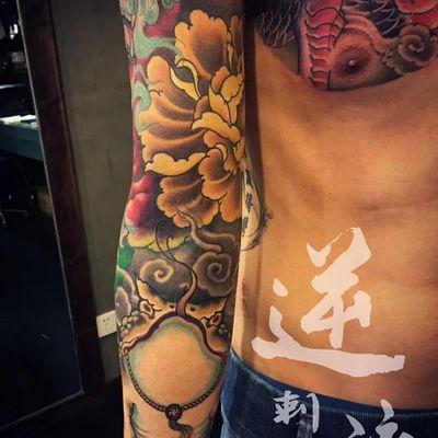唐狮子花臂纹身图